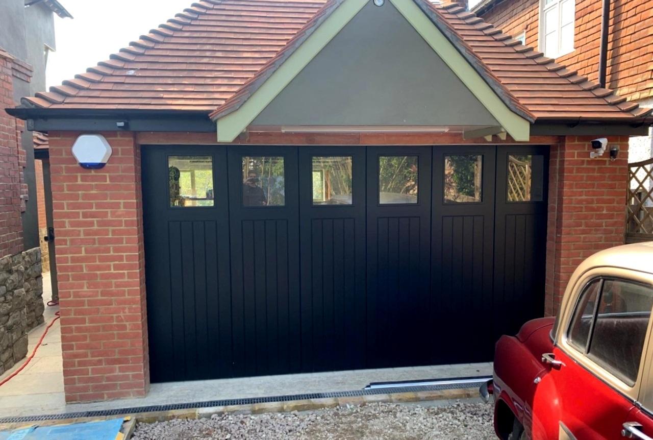 Rundum Meir timber bespoke side sliding sectional garage door.